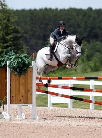 Veronica Bot and Calators Charles - 2014 Canadian 1.40m Jr/Am Champion - Chris Delia Stables is a full-service 'A' circuit show barn offering individualized coaching programs for hunter, jumper and equitation riders.